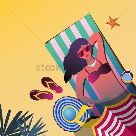 Swimsuit : Female sun tanning on a beach
