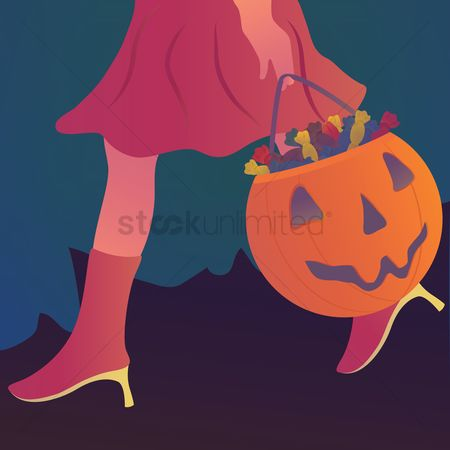 Jack o lantern : Girl carrying trick or treat basket with candies