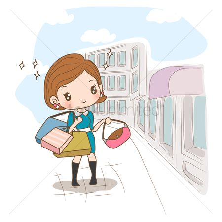 Fashions : Girl with shopping bags standing on street