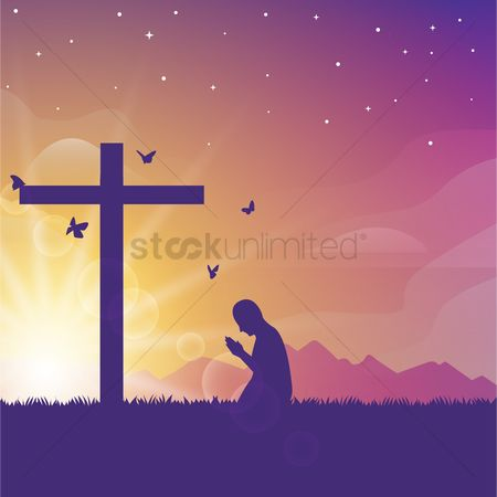 Grass : Person praying at a cross