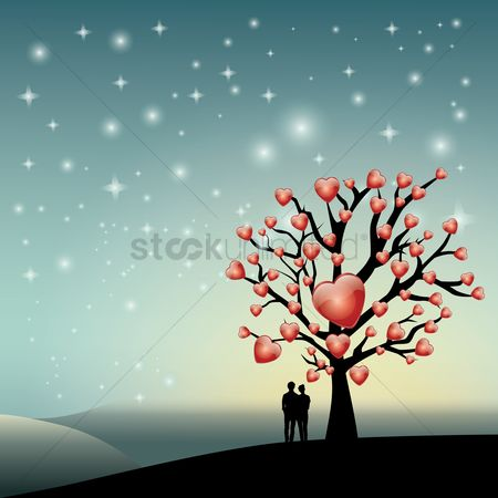Love : Silhouette of couple standing near love tree