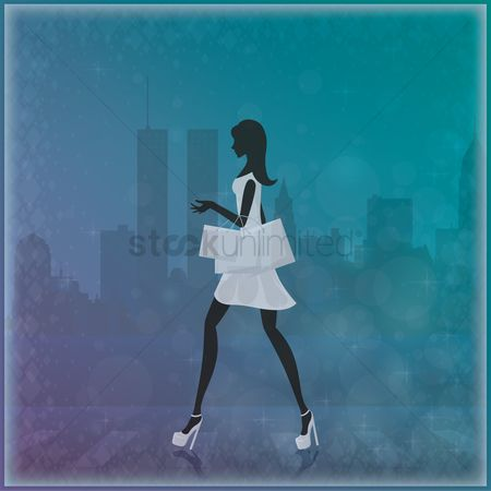 Shopping background : Woman holding shopping bags