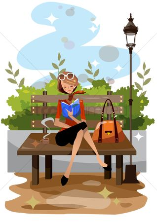 Lifestyle : Woman reading a book in a park