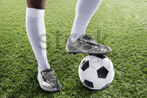 a soccer player ready to kick off stock photo