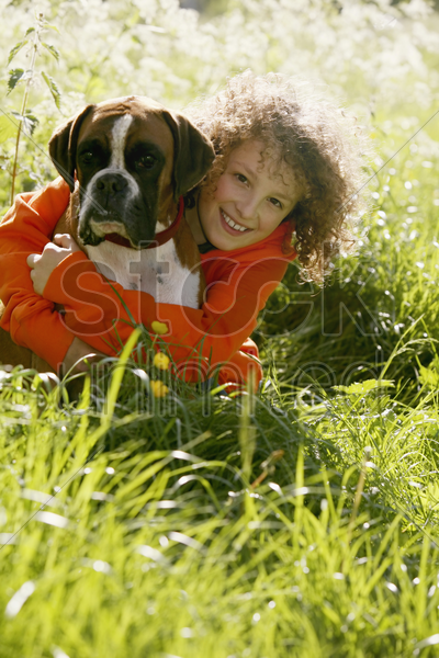 boy hugging his dog stock photo