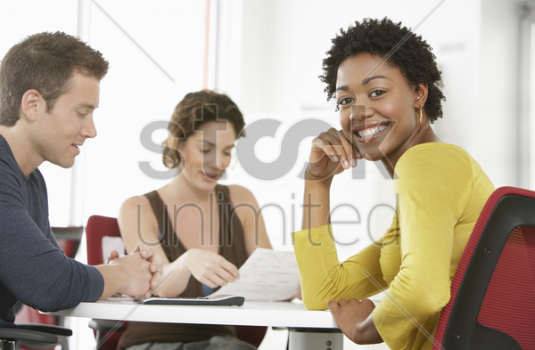 business colleagues in office meeting portrait stock photo