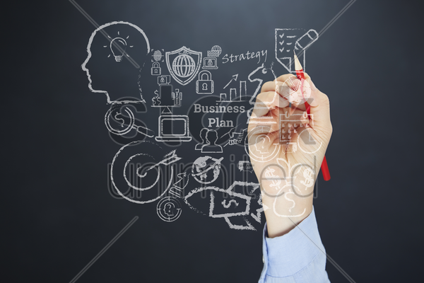 business plan drawn on board concept stock photo