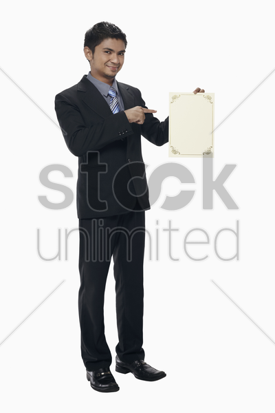 businessman holding a blank certificate stock photo