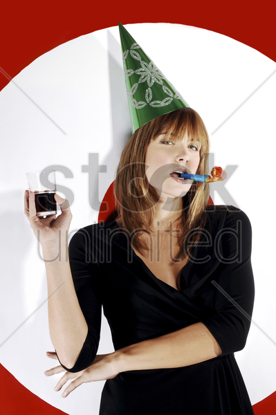businesswoman with party hat celebrating stock photo