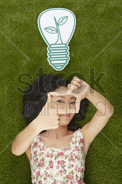 cheerful woman showing hand gesture stock photo