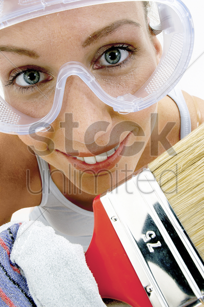 close-up of a woman with goggles holding a brush stock photo