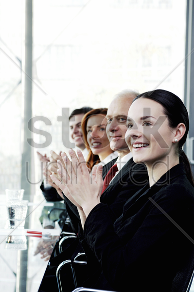 corporate people clapping hands in the meeting room stock photo
