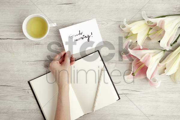 flat of wooden background and lilies stock photo