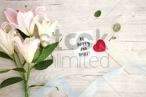 flat of wooden background with lilies stock photo