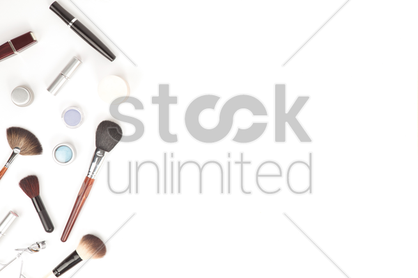 flatlay of white background with makeup accesories stock photo