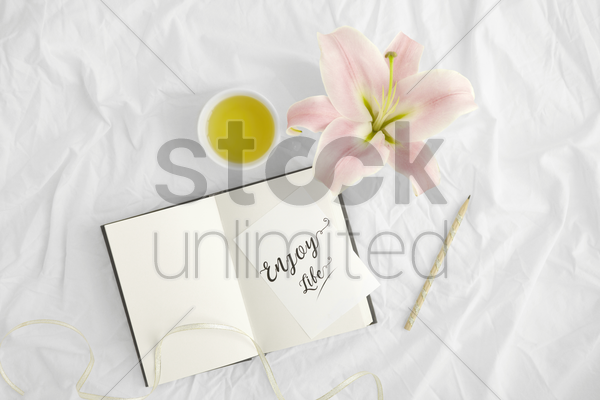 flatlay of white cloth background with lilies stock photo