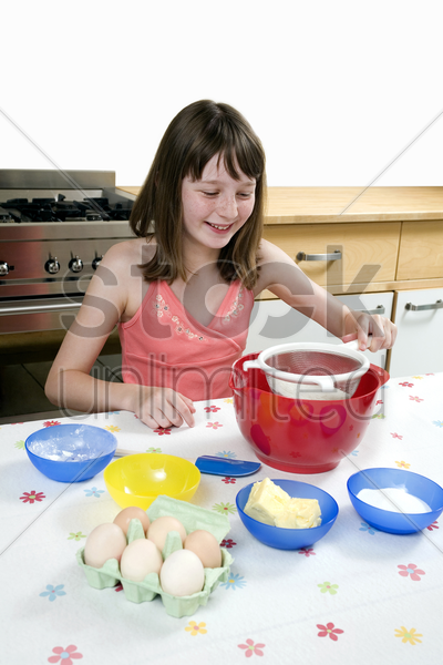girl learning baking stock photo