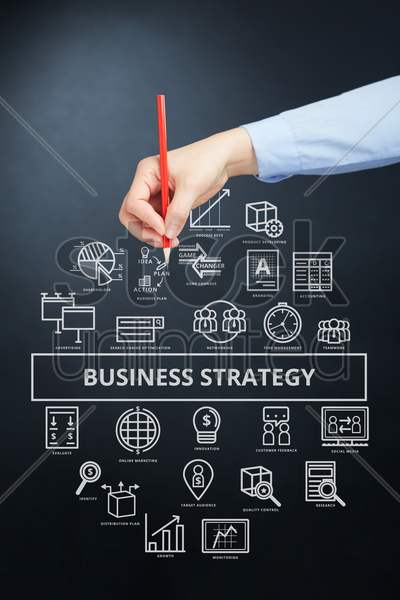 hand holding a pencil with business strategy concept stock photo
