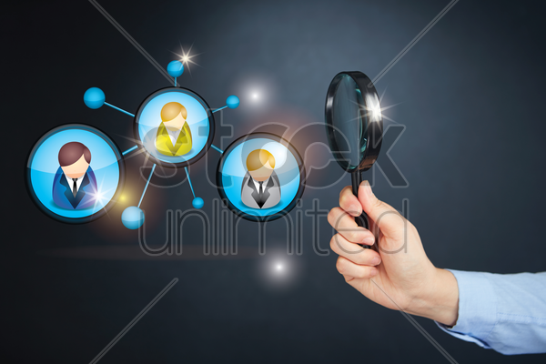 hand holding magnifying glass with networking concept stock photo