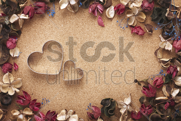 heart shaped cookie cutter with dried flowers stock photo