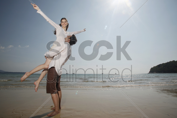 man lifting up woman stock photo