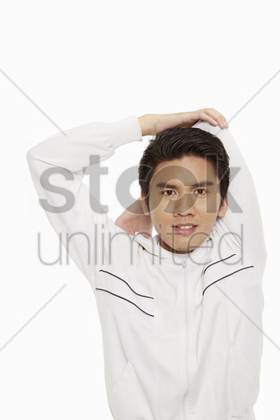 man stretching his left arm stock photo