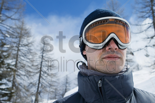 man wearing goggles stock photo