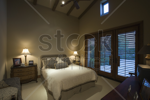 palm springs bedroom at dusk stock photo