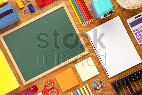 school supplies on desk background with copy space stock photo