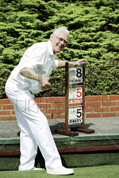 senior man showing thumbs up after checking the scoreboard stock photo