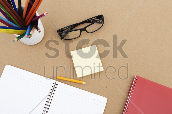 spectacles with stationery set stock photo