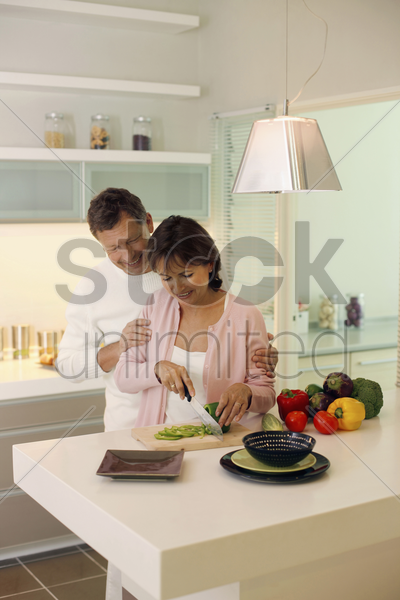 woman cutting vegetable stock photo