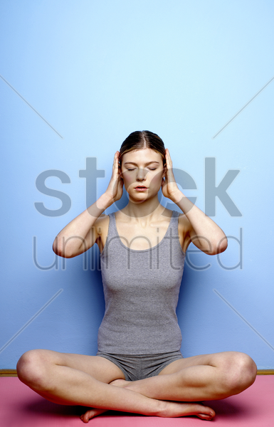 woman practicing yoga stock photo