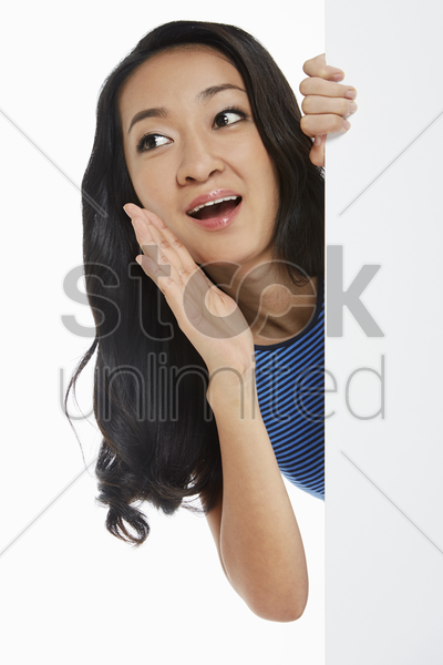 woman shouting and calling out stock photo