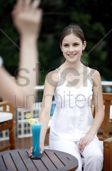 woman smiling while looking at her friend stock photo