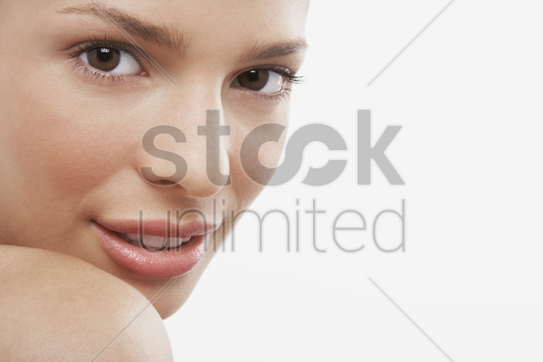 young woman looking over shoulder stock photo
