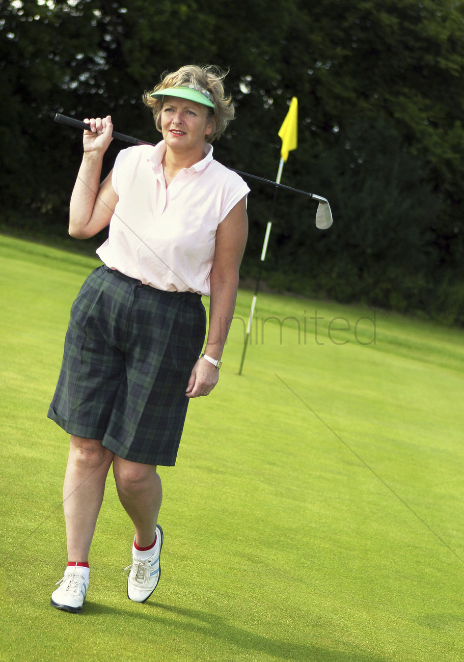 an old lady in golf attire standing in a golf course stock photo 1677043 stockunlimited. Black Bedroom Furniture Sets. Home Design Ideas