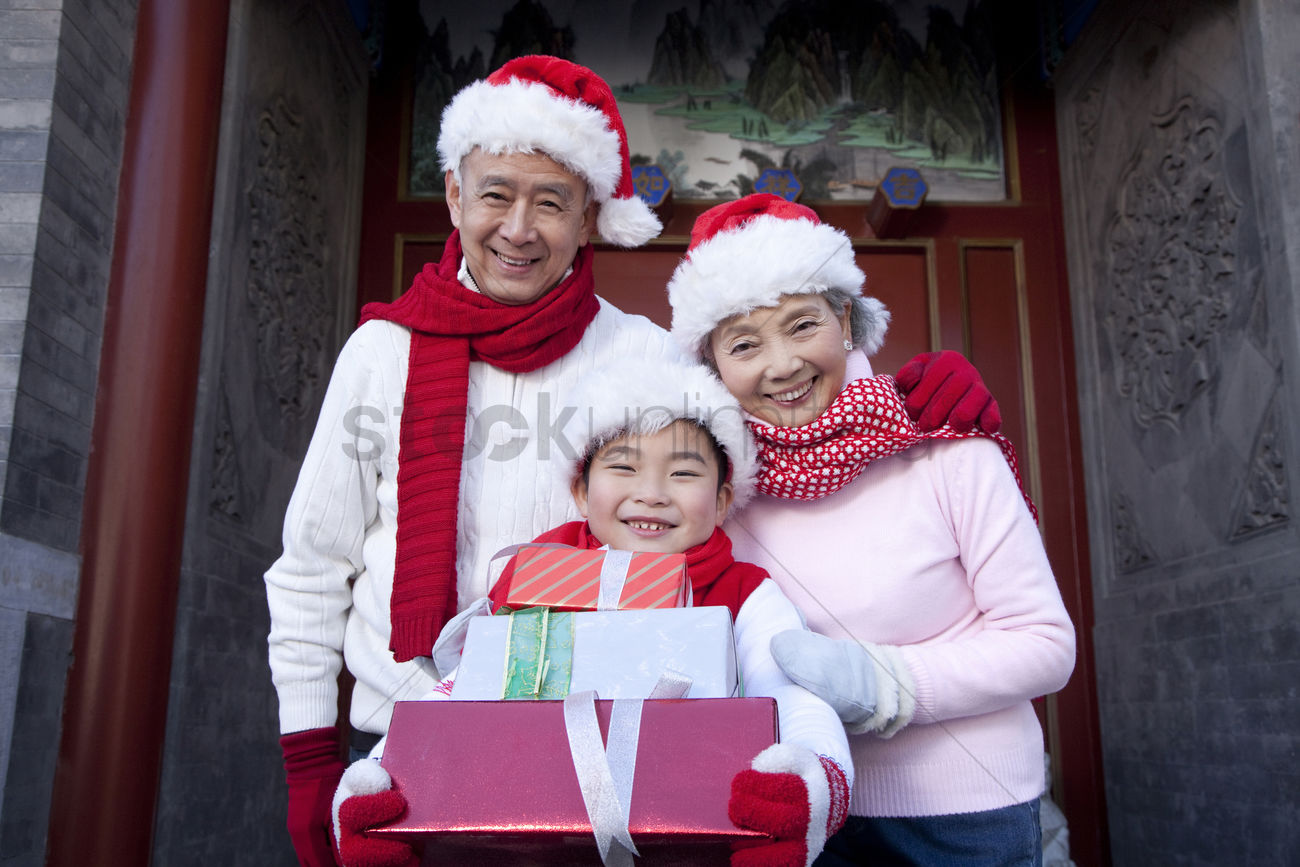 Family holding christmas gifts Stock Photo - 2109183 | StockUnlimited