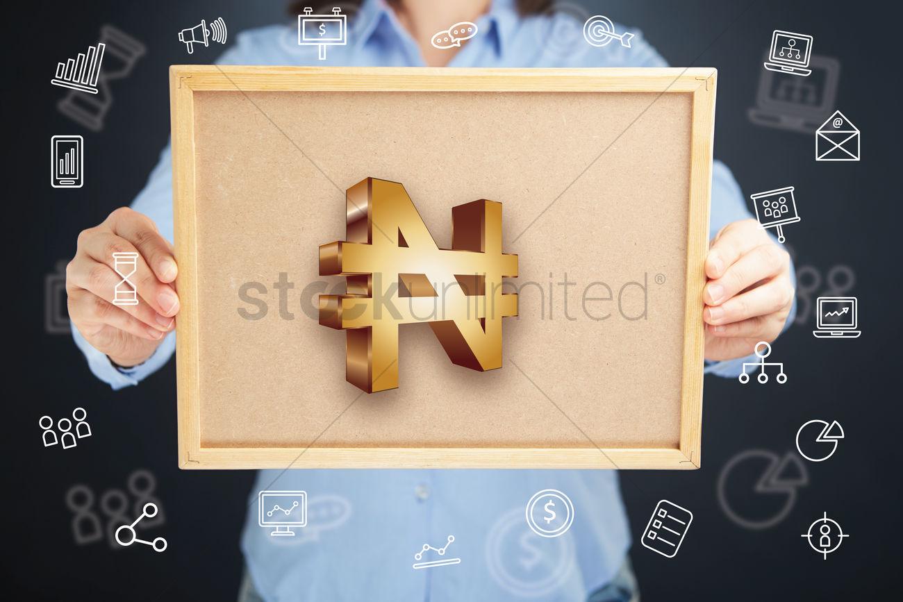 Hands Presenting Nigerian Naira Currency Symbol On Cork Board