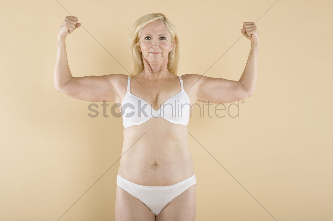 Mature women smiling nude Mature Woman Flaunting Her Biceps And Smiling Stock Photo 1916631 Stockunlimited