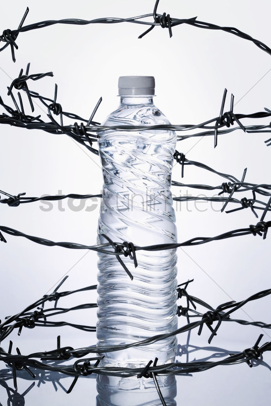 Plastic bottle surrounded by barbed wire Stock Photo - 1703487 ...