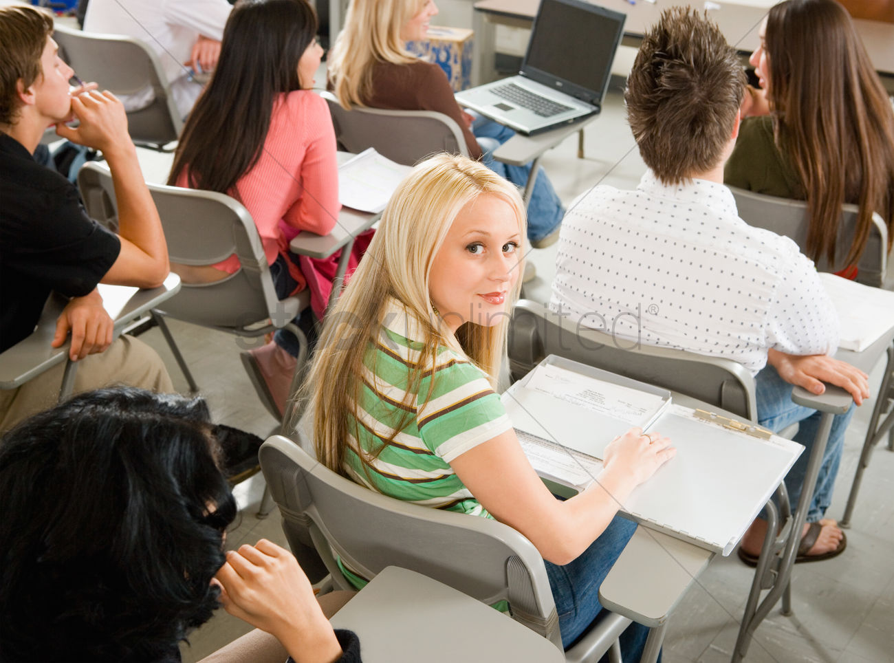 Student Sitting At Desk During Cl Portrait Stock Photo