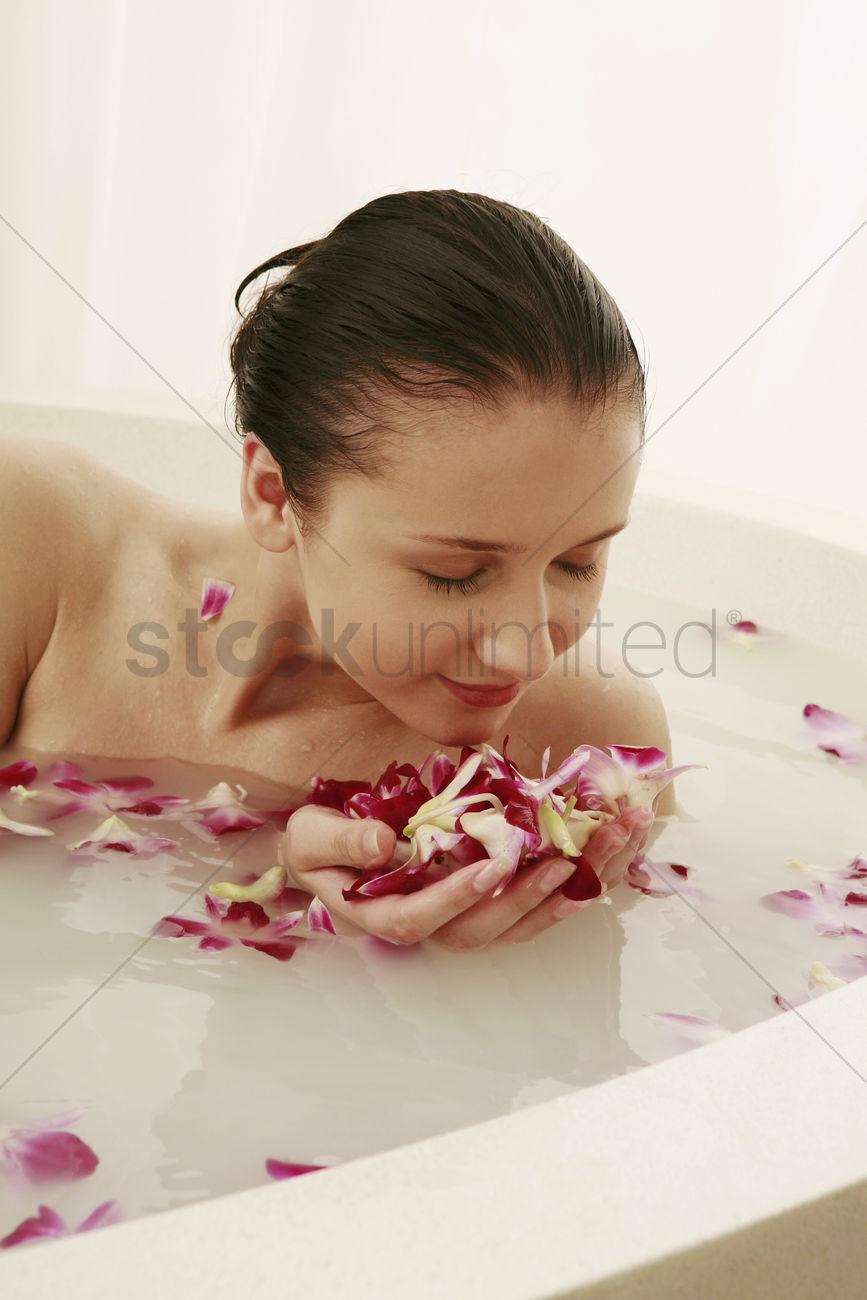 Woman having flower bath Stock Photo - 1688603 | StockUnlimited