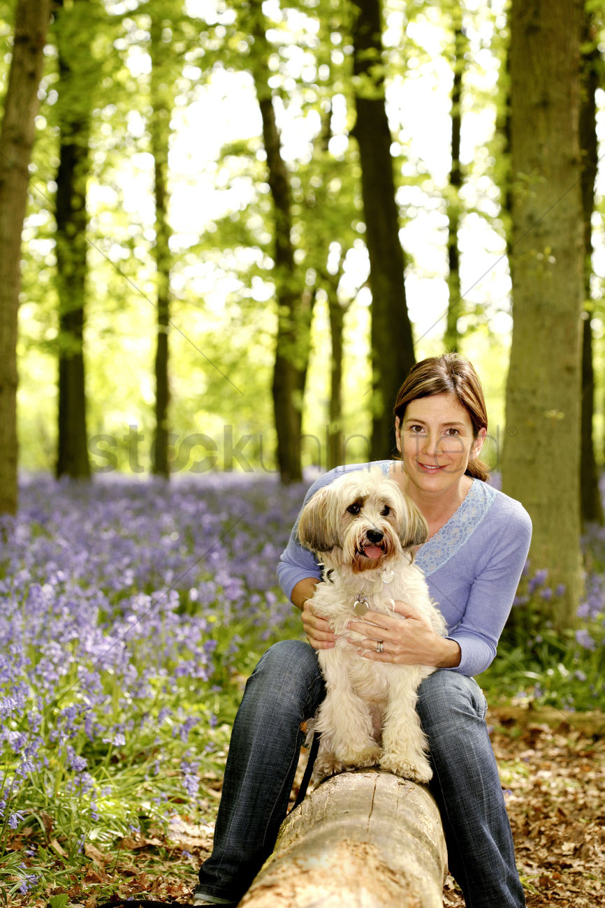 Woman posing with her dog Stock Photo - 1680191
