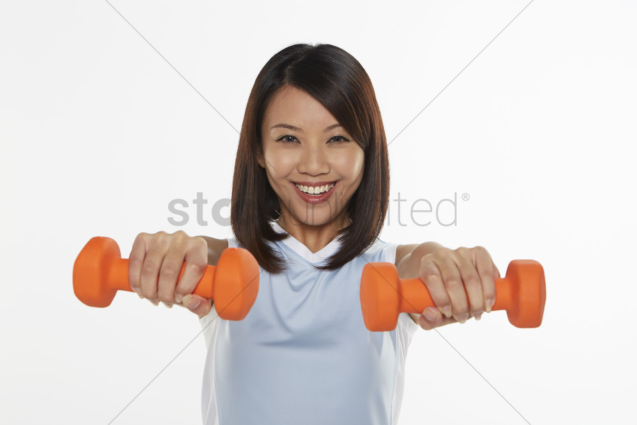 woman stretching using dumbbells stock photo 1855839 stockunlimited