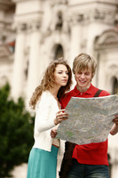 A man and woman referring to a map for direction