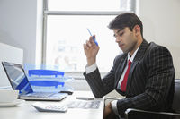An indian businessman working at office desk