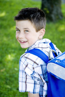 Boy carrying school bag on his back