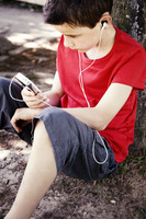 Boy listening to music on a portable mp3 player