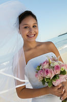 Bride with bouquet on beach  portrait